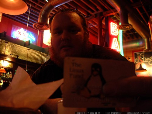 stephen, showing off his linux credit card   dscf0623