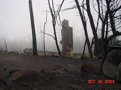after the cedar fire   chimney is all that remains  …