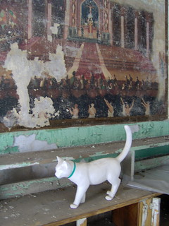 ghost cat with mural