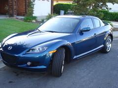 mazda3(0.0), mazdaspeed3(0.0), automobile(1.0), automotive exterior(1.0), wheel(1.0), vehicle(1.0), automotive design(1.0), mazda(1.0), rim(1.0), bumper(1.0), land vehicle(1.0), luxury vehicle(1.0), mazda rx-8(1.0), sports car(1.0),