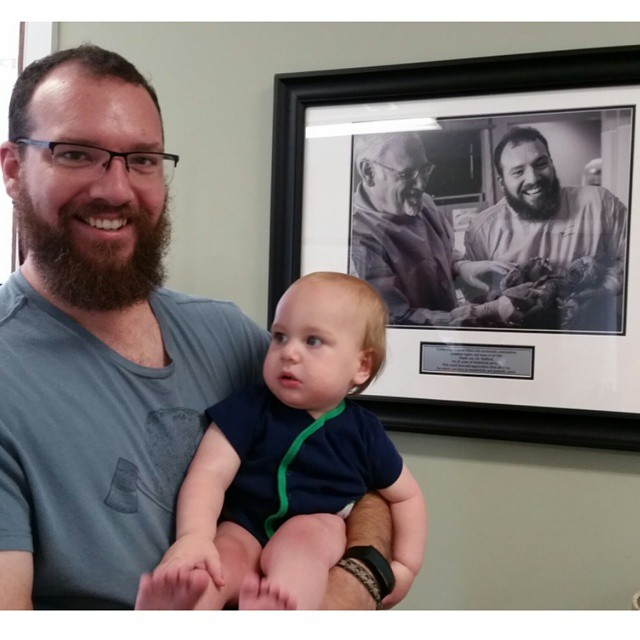 1 year old Orion and dad in front of a photo of the moment they met on this day last year. #orionjohnis1 #mightyoriongram #babysuplicki