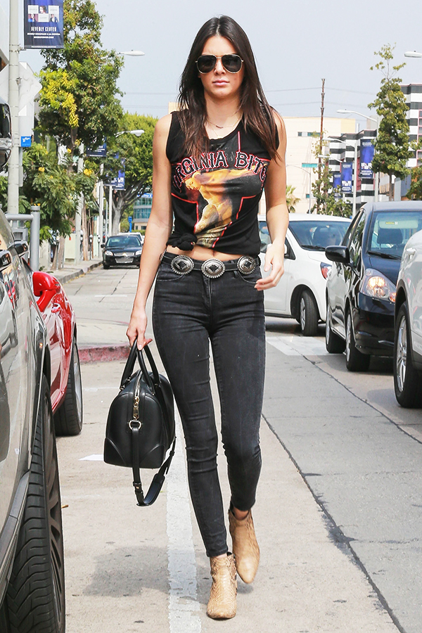 Kendall Jenner wearing Givenchy Virginia Bitch T-Shirt, Saint Laurent Python Ankle Boots, Givenchy Lucrezia Bag, 3x1 High Rise Channel Seam Skinny in Black No.5