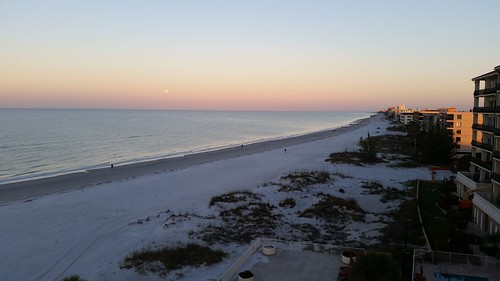 lunar eclipse moon sky beach sand surf water waves sunrise landscape madeirabeach treasureisland florida lovefl gulf gulfofmexico beachresort commodorebeachclub horizon clouds penumbral fullmoon dunes sanddunes