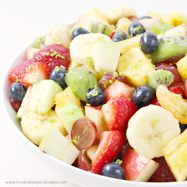 This Rainbow Fruit Salad with Honey Citrus Dressing is a great addition to breakfast or it makes a healthy snack idea any time! Easy to make ahead and enjoy all week! #WrapNGo #Ad
