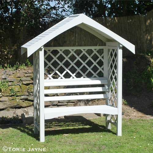 Painted white arbour