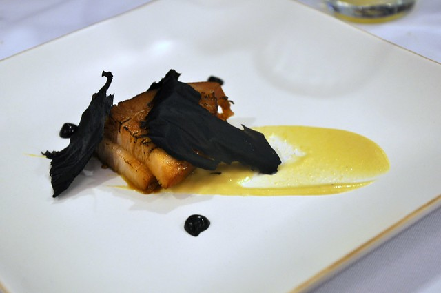 Tare roasted pork in uni dashi with squid ink onion chips