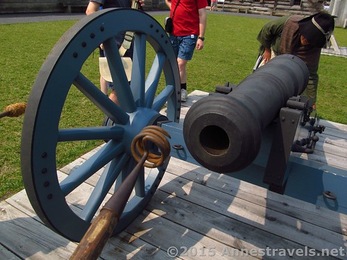 Getting ready to fire the canon. Kelly checks to make sure it's aimed correctly. Fort Stanwix National Monument, New York