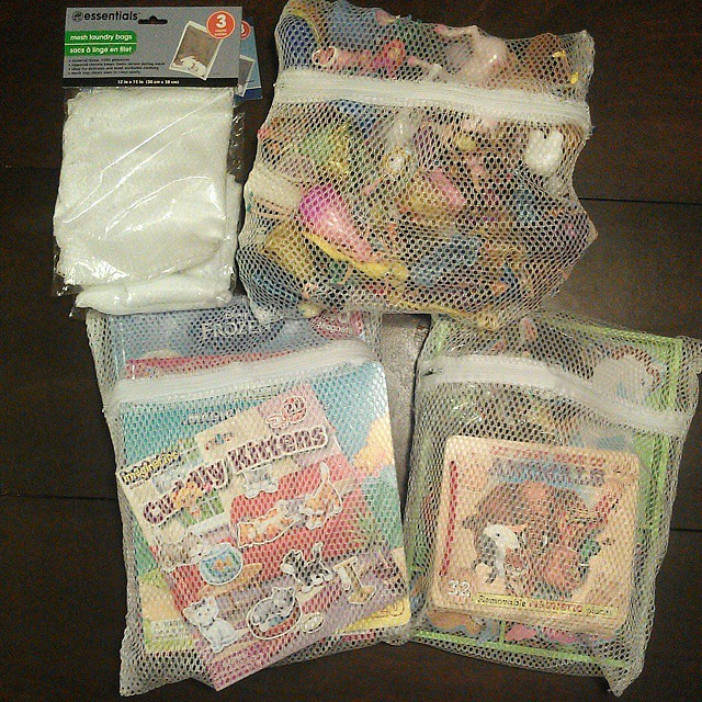 Making more activity packs for the girls. I'm slightly obsessed with this organizational idea. The mesh laundry bags come in a pack of 3 for $1. They are perfect for holding wooden puzzles, so you don't lose the pieces, and a great way to contain all thos