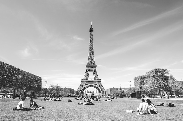 A sunny day in Paris means a crowd at the Champ de Mars and the Eiffel Tower.