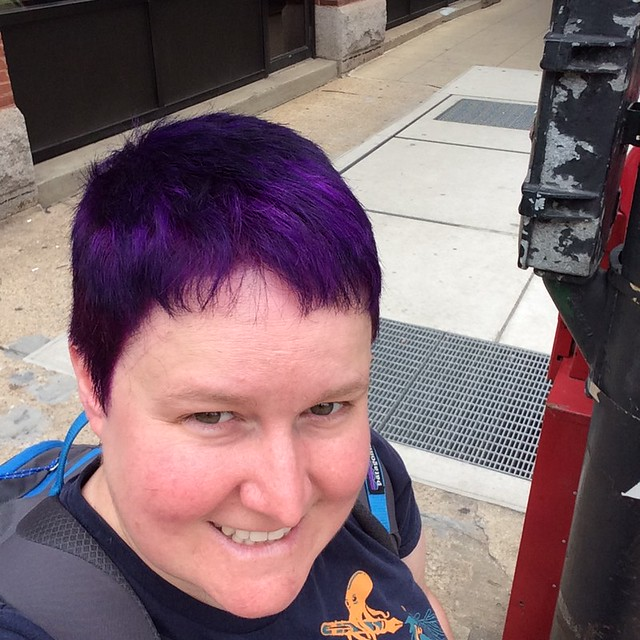 Purple, short hair and a big smile!