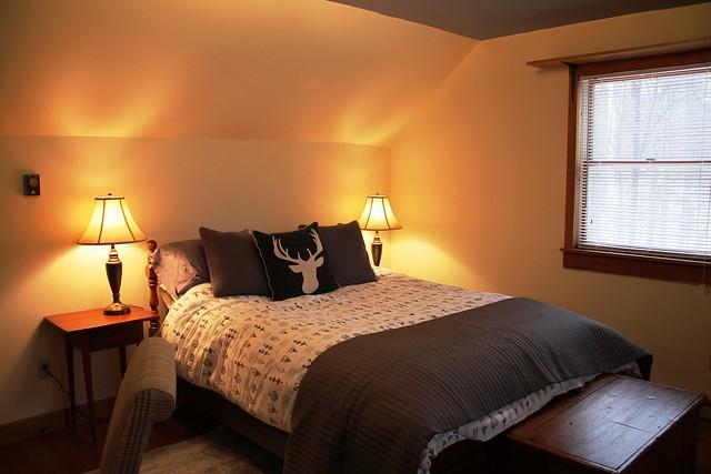 Guest Bedroom with queen bedroom; rustic style bedding;
