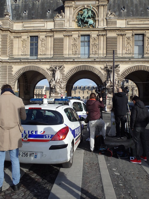 Police and reporters beside The Louvre