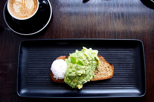 Flat White Coffee and Brunch in Melbourne - Dr. Jekyll Cafe (107-113 Grey Street, St. Kilda) - avocado and Meredith feta mash, with mint and lemon on rye toast, with a poached egg