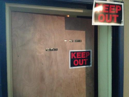 Open door marked private