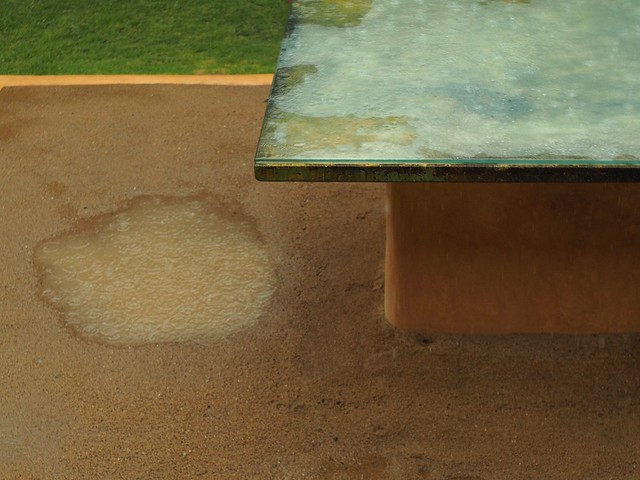 Rain falling on an outdoor ping pong table
