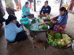village women preparing food for monks, Madahya Kyaung monastery