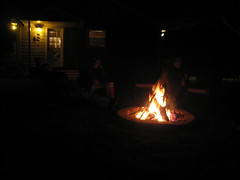 Everyone sits around the fire