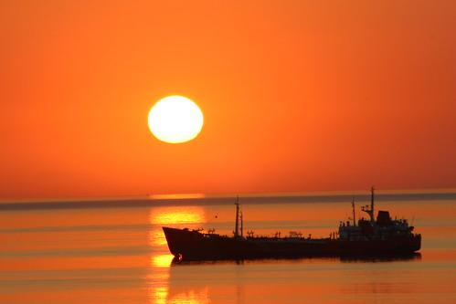 sea sunrise ships