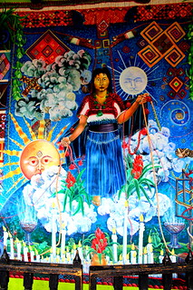Mural of Weavers connected to the earth.