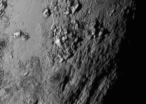 First Ever High Resolution View of Pluto's Surface