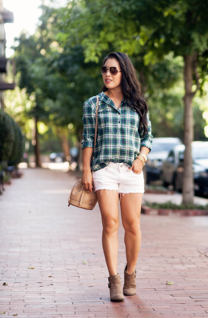 cute & little blog | green plaid shirt, white distressed shorts, ankle booties, brown aviators, bucket bag | summer fall outfit