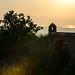 Fin de journée sur la citadelle de Korçë avec au fonds le soleil couchant sur la mer adriatique - Albanie