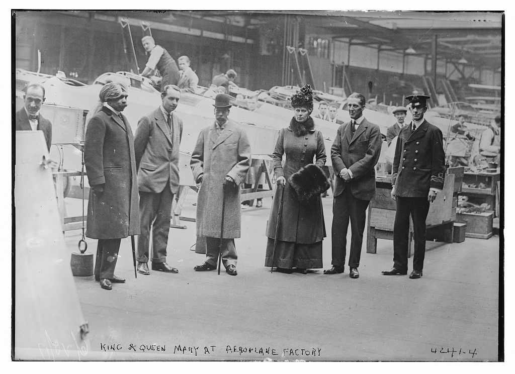 King & Queen Mary at aeroplane factory (LOC)