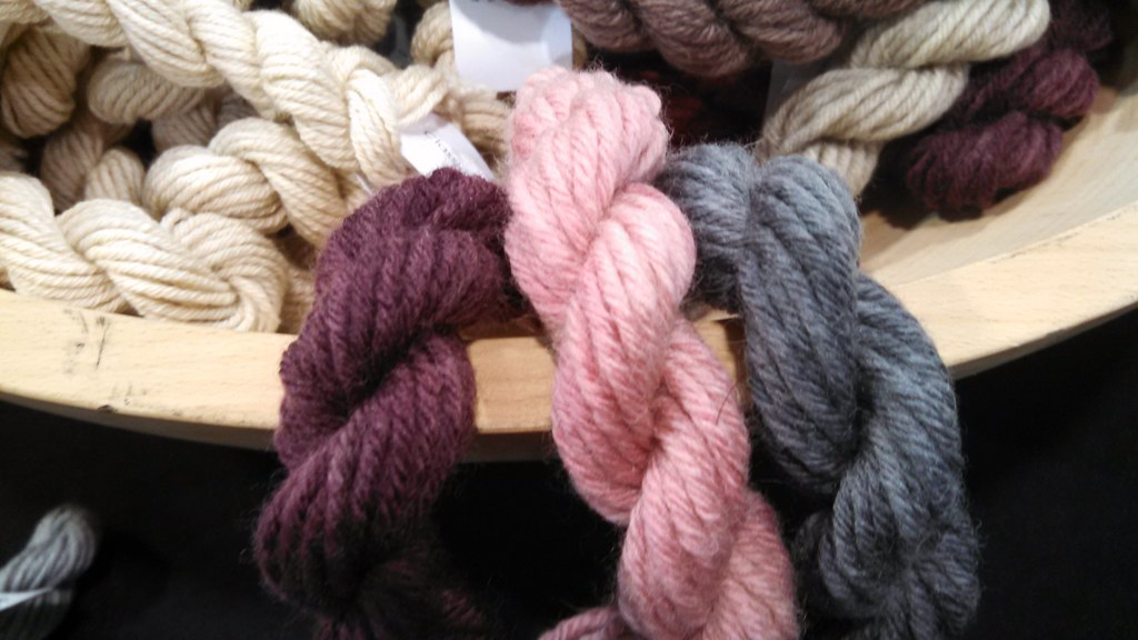 mini-skeins of CEY's Big Liberty Wool in grey, pink and purple.