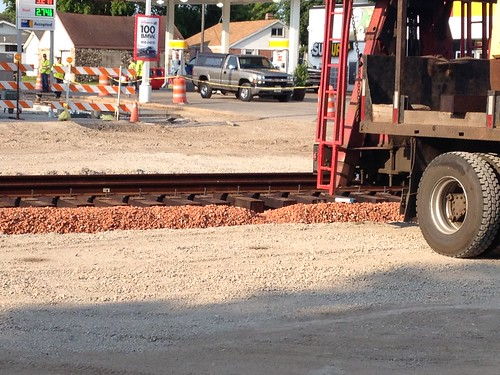 7/2/15 Oconto Falls update-  all rails have been connected. Appears the workers are placing the outer black panels that go next to the rail for vehicular traffic.