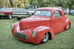 1937 ford(0.0), mid-size car(0.0), automobile(1.0), automotive exterior(1.0), wheel(1.0), vehicle(1.0), city car(1.0), compact car(1.0), hot rod(1.0), antique car(1.0), land vehicle(1.0), motor vehicle(1.0),