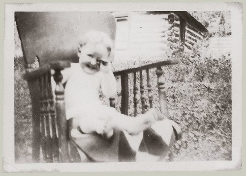 Baby in chair outside