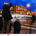 People photographing the iconic Honest Ed's sign before it closes its doors on December 31, 2016. by Vincent Demers - vincentphoto.com