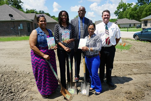 Self-Help applicants Jacqueline Campbell, Paulette Alexander, and Kimberly Dunn received a present of seeds to start a garden after constructing their new homes. Standing in the back is USDA RD State Director Clarence W. Hawkins and John Audibert, USDA RD Housing Specialist.