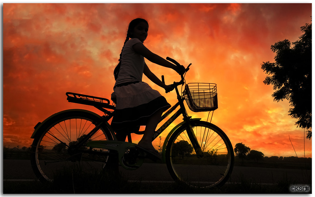 Girl at dusk riding homewards!