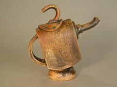 jug(0.0), wood(0.0), pottery(0.0), pitcher(0.0), drinkware(0.0), horn(0.0), mug(0.0), ceramic(0.0), teapot(0.0), art(1.0), metal(1.0), iron(1.0), antique(1.0), brass(1.0),