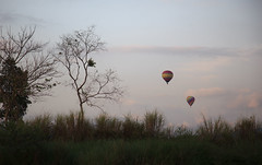 Two air balloons at sunset over Vang Vieng, Laos