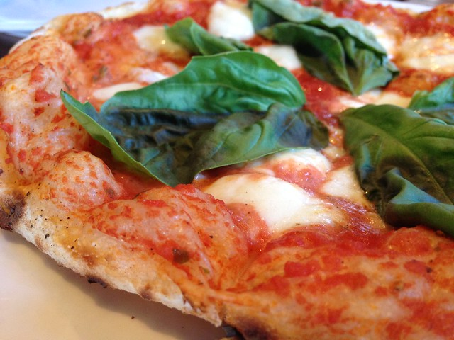 Pizza Margherita: tomato, house-pulled Mozzarella cheese, and basil
