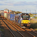 ScotRail liveried 68006 'Daring' powers south through Carnoustie with a well loaded 4N83 Craiginches to Grangemouth 'intermodal' by Tayrail