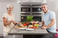 Man Woman Couple Making Sandwiches in Kitchen