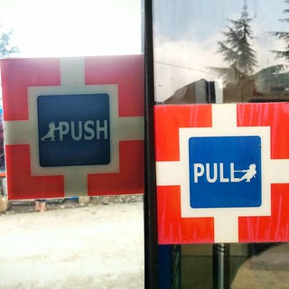 HDFC uses subtle illustrations for their Pull and Push signs. I have so many questions!