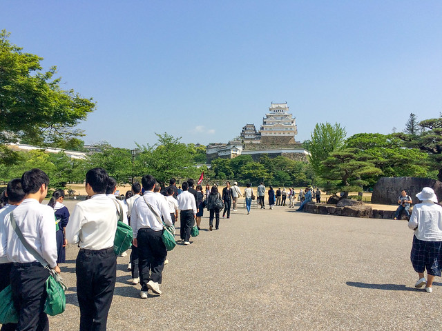 School kids walking towards Himeji Castle.