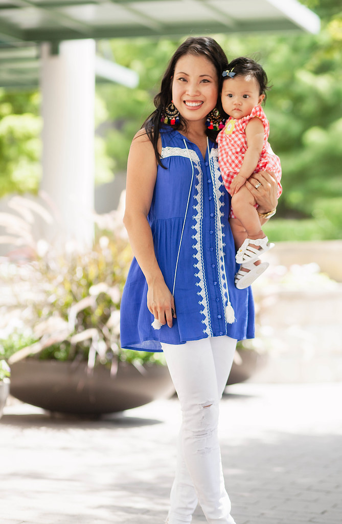 cute & little blog | petite fashion | blue white embroidered linen tassel tank, distressed white jeans, nude espadrille wedges, tassel statement earrings | mommy + me summer outfit