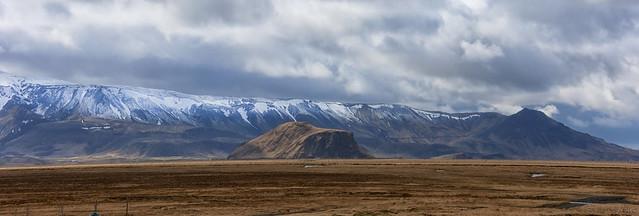 Eyjafjallajokull massif ducking under the rain