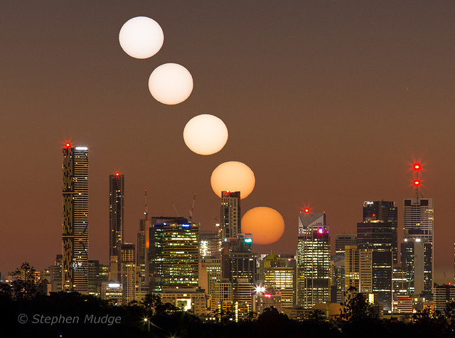 Aphelion sunrise behind Brisbane city small