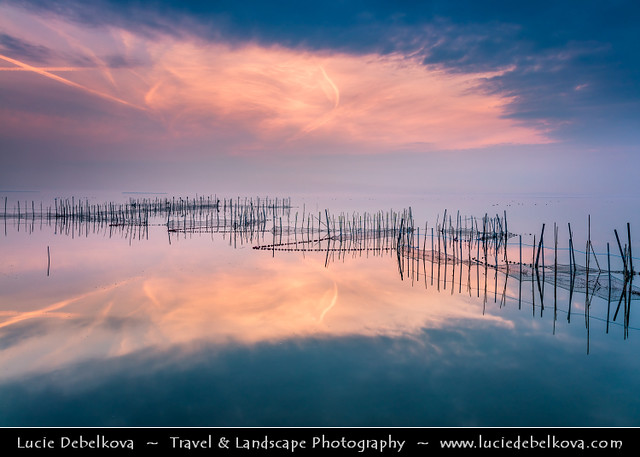 Spain - Valencia's Albufera Natural Park - L'Albufera lake with fishing nets at Sunset