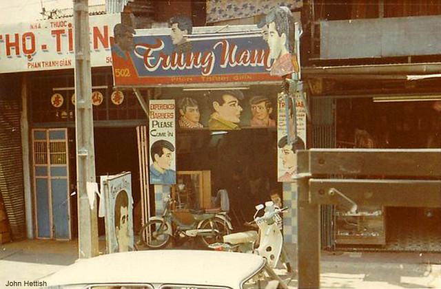Saigon 1970-71 by John Hettish - A Vietnamese barber shop.