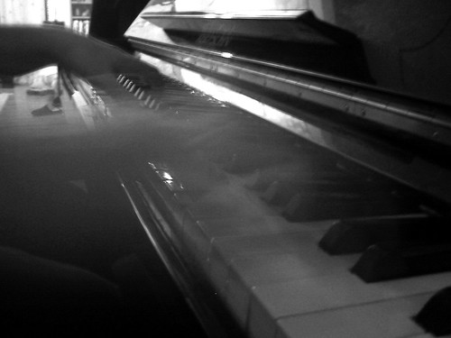 Blurred piano playing (B&W)