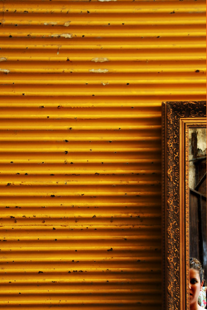 her face framed in yellow