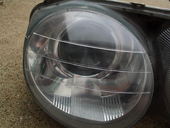 tire(0.0), automotive tire(0.0), window(0.0), wheel(0.0), rim(0.0), grille(0.0), alloy wheel(0.0), bumper(0.0), spoke(0.0), automotive tail & brake light(1.0), automotive exterior(1.0), automotive lighting(1.0), light(1.0), headlamp(1.0),