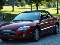 executive car(0.0), automobile(1.0), automotive exterior(1.0), vehicle(1.0), chrysler sebring(1.0), automotive design(1.0), chrysler(1.0), bumper(1.0), sedan(1.0), personal luxury car(1.0), land vehicle(1.0), luxury vehicle(1.0), coupã©(1.0), convertible(1.0),